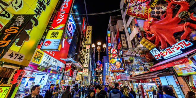 View of the street foods to try In Dōtonbori, the famous food market in Osaka, Japan.