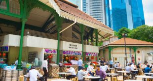 People eating at one of the most popular hawker centers in Singapore.