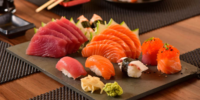 Nigiri, salmon and tuna on a plate. How to eat sushi is one of the things you should know about Japanese cuisine.