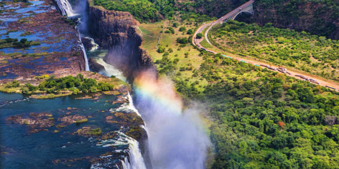 Rainbow over Victoria Falls in Zimbabwe, a must stop during a foodie's day in Harare.