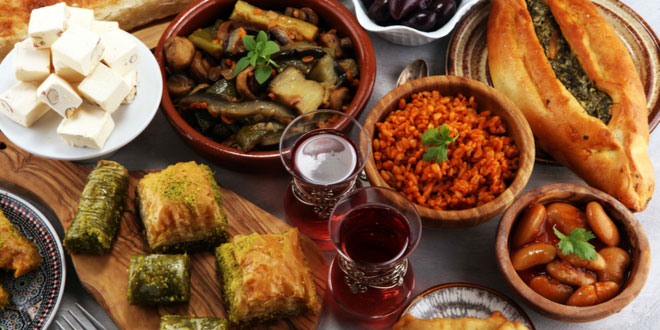 Assortment of Middle Eastern or Arabic Halal foods on concrete rustic background.
