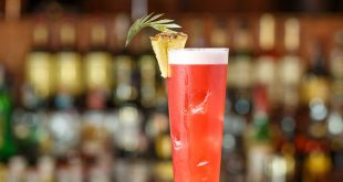 Singapore sling cocktail in a tall glass at the Long Bar of the Raffles Hotel