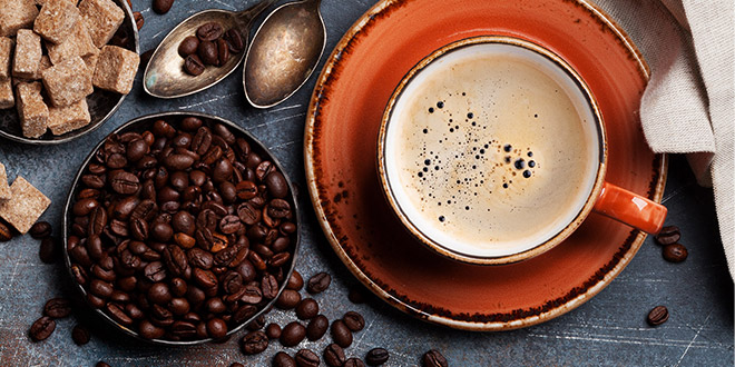 Roasted beans and a cup of coffee, waiting for their perfect coffee pairings